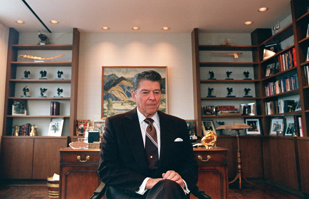 Former US President Ronald Reagan sits 09 June 1989 in his office in Century City near Los Angeles. Reagan was US president from 1980 to 1988.