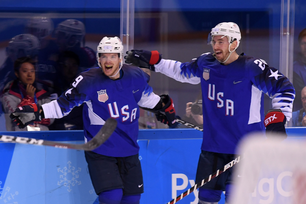 Brian O'Neill (#9) and Jonathon Blum (#24) of the United States celebrates after O'Neillc scored a goal against Slovenia in the PyeongChang 2018 Winter Olympics on February 14, 2018.