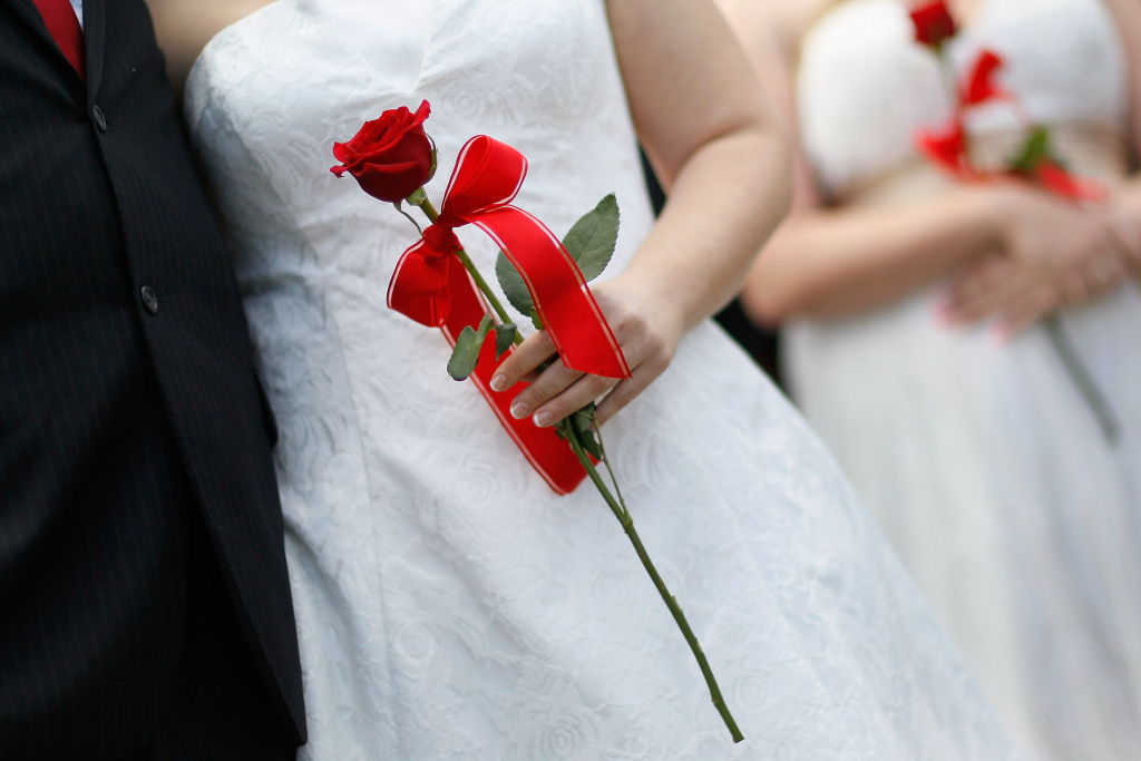 Brides hold their roses