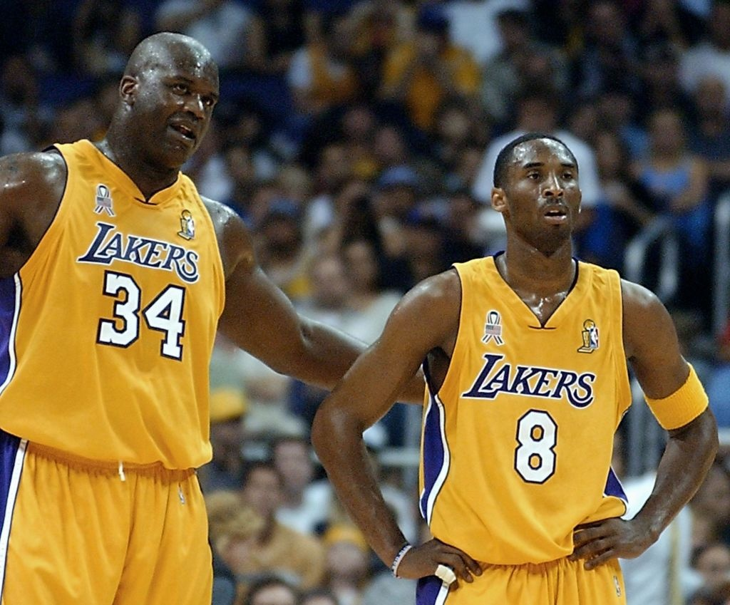 Shaquille O'Neal and Kobe Bryant of the Los Angeles Lakers talk during the 1st quarter of game two of the NBA Finals against the New Jersey Nets 07 June 2002 at the Staples Center in Los Angeles, CA.