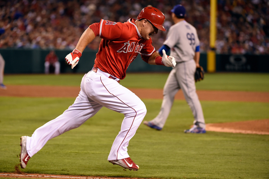 Mike Trout #27 of the Los Angeles Angels of Anaheim runs to first base in the sixth inning against the Los Angeles Dodgers at Angel Stadium of Anaheim on August 7, 2014 in Anaheim, California.