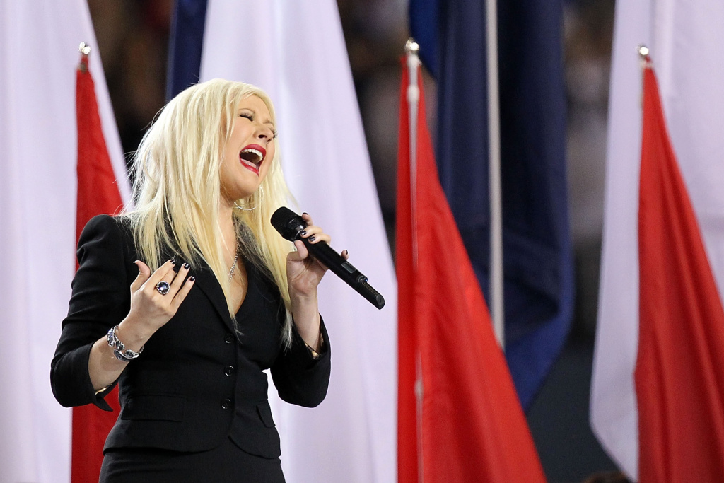 Singer Christina Aguilera sings the national anthem during Super Bowl XLV at Cowboys Stadium on February 6, 2011 in Arlington, Texas.