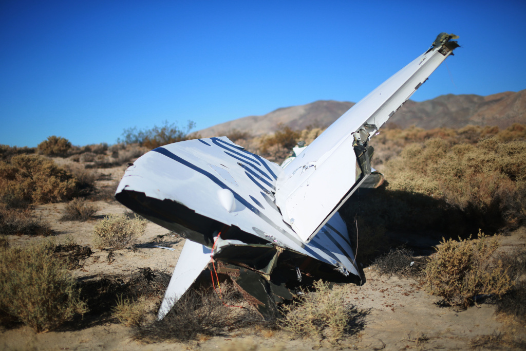 Debris from Virgin Galactic SpaceShip 2 sits in a desert field November 2, 2014 north of Mojave, California. The Virgin Galactic SpaceShip 2 crashed on October 31, 2014 during a test flight, killing one pilot and seriously injuring another.
