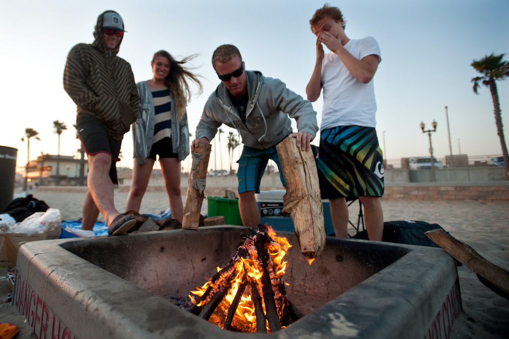 Zachary Martin, Danielle Dalton and Dane Johnson of Rancho Cucomonga and Kyle Lucas of Newport Beach often spend the day at Huntington Beach and have a bonfire in the evening.