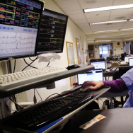 Amanda Gerity, a staff nurse at Boston Medical Center, checks monitors that track patients' vital signs. Fewer beeps means crisis warnings are easier to hear, she says.