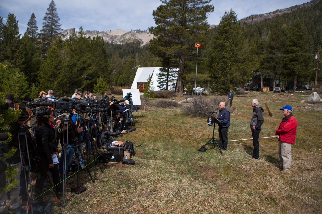 California Governor Jerry Brown speaks to reporters at the site of a manual snow survey on April 1, 2015 in Phillips, California. The recorded level is zero, the lowest in recorded history for California. Gov. Brown went on to announce mandatory statewide water restrictions.