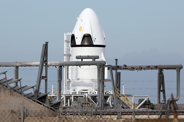 SpaceX's crew Dragon capsule is poised on a launch pad on Tuesday, May 5, 2015, ready for Wednesday's test flight. This is SpaceX's proposed new technology for saving astronauts once it starts ferrying them to and from the International Space Station in 2018.