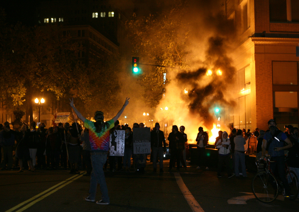 The Occupy Oakland protesters set a fire on trash to make a barricade as the police officers form a line to disperse the protesters on November 3, 2011 in Oakland, California.