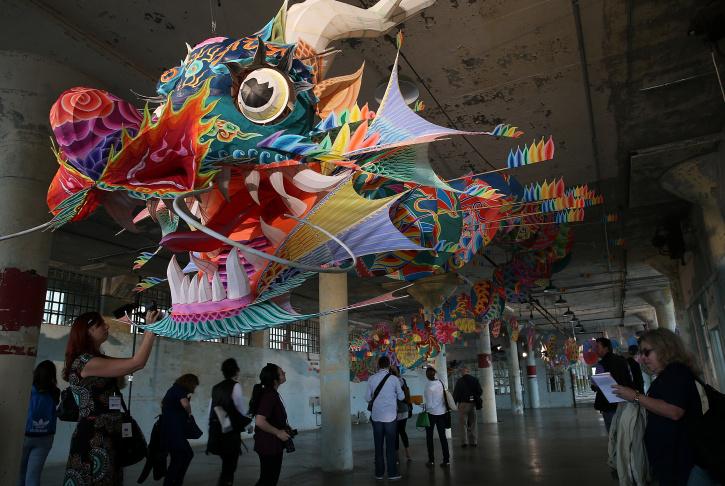 SAN FRANCISCO, CA - SEPTEMBER 24:  Visitors look at Ai Weiwei's