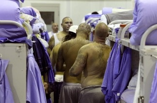 Inmates at the Mule Creek State Prison crowd between bunk beds in a gymnasium that was modified to house prisoners  in Ione, California. The Mule Creek State Prison has had to modify several facilities to make room for an increasing number of inmates.