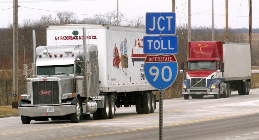 Tractor-trailers move along an interstate frontage road in January 2004 in Hampshire, Illinois. The U.S. Department of Transportation introduced new rules that include an increase in the amount of rest truck drivers must take between shifts, and an increase in the allowable number of driving hours per shift