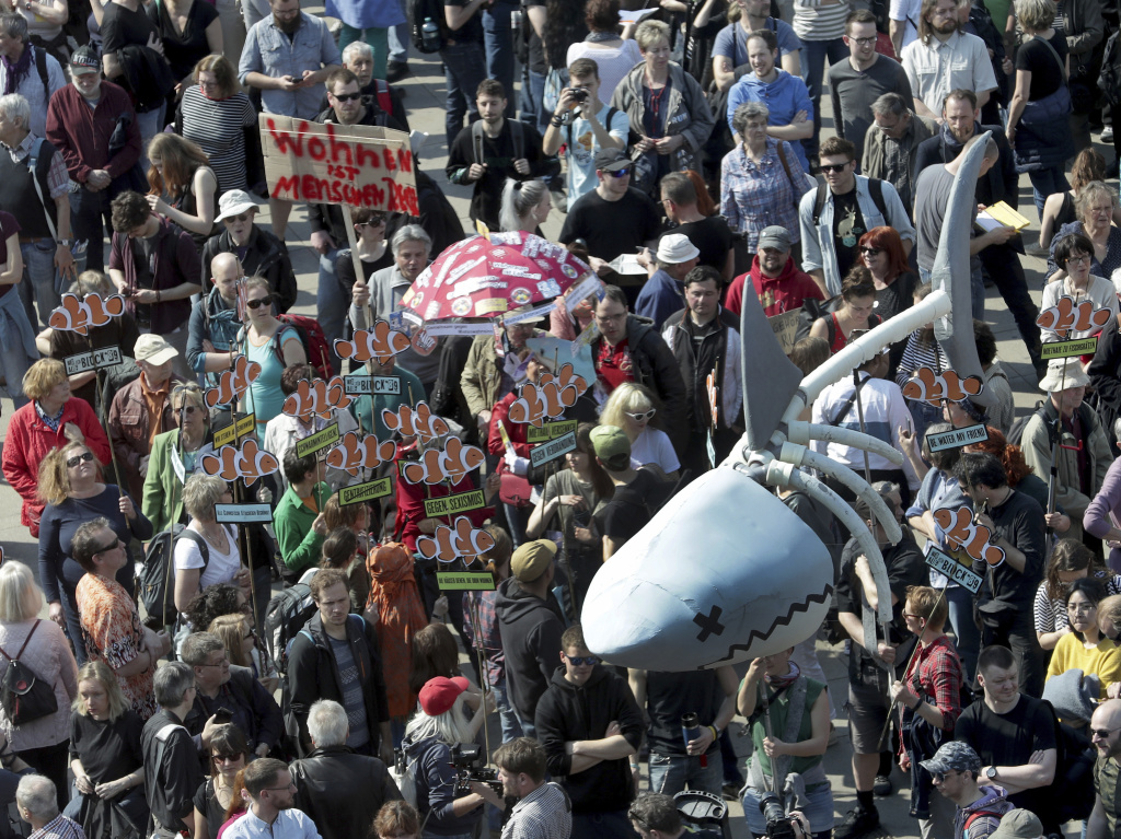 Protesters in Berlin carry a giant