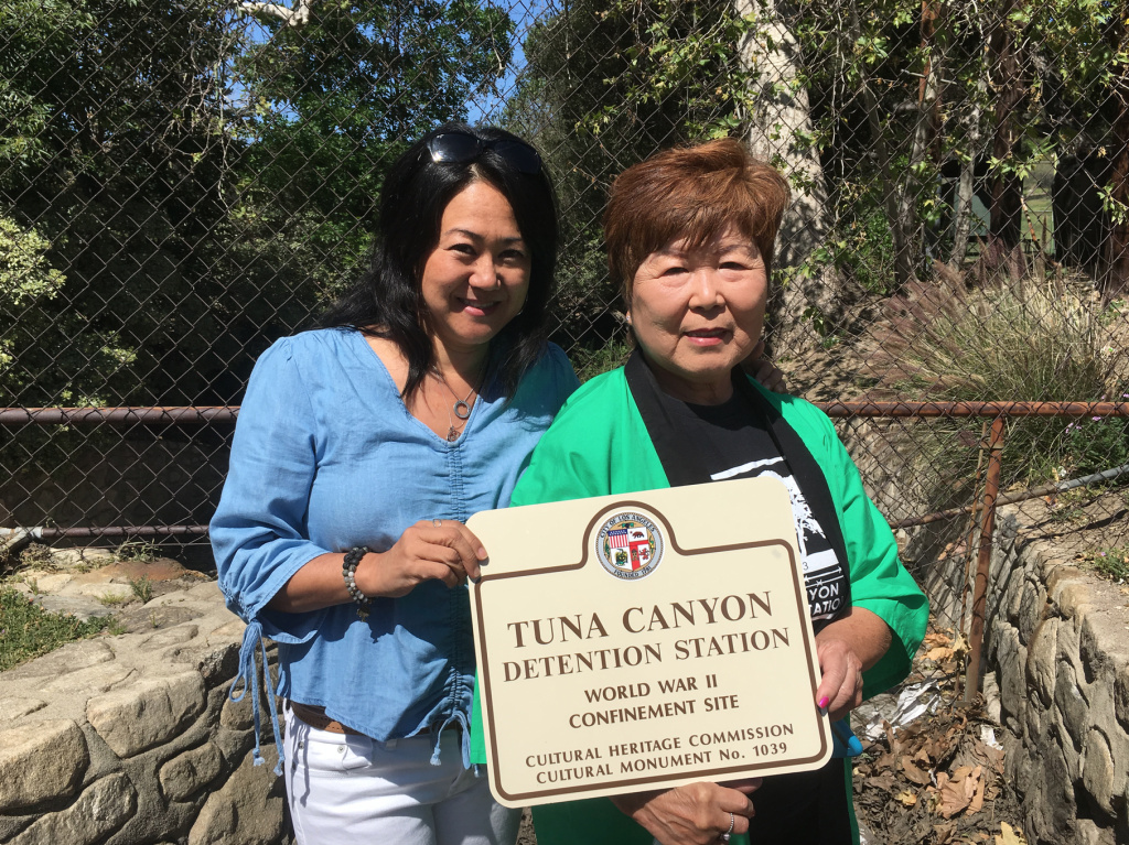 Donna Sugimoto, left, and Nancy Oda at the site of the former Tuna Canyon Detention Station, designated a historic-cultural monument by the city of Los Angeles. A sign commemorating the site's history as a detention camp for Japanese, Italian and German immigrants during WWII was unveiled Thursday.
