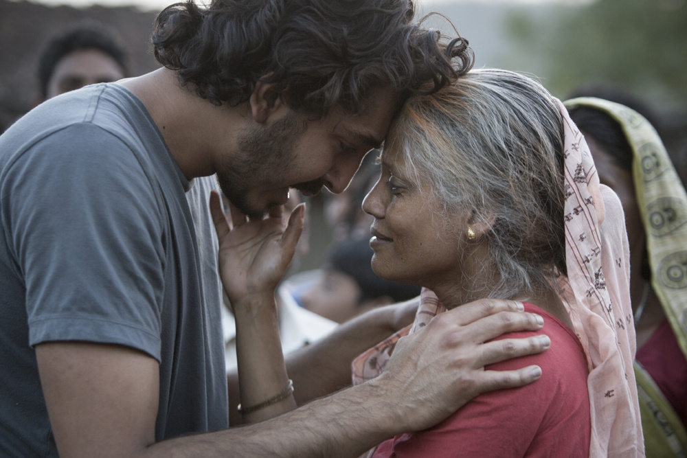 Dev Patel and Priyanka Bose, who plays his birth mother, in a scene from