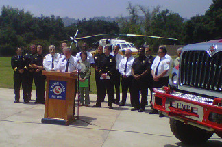 Representatives from local, state and federal agencies announce on June 8, 2010 new firefighting strategies in advance of peak fire season.