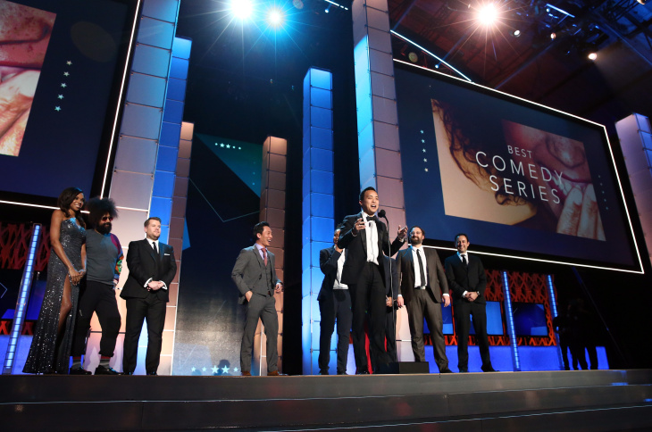 (L-R) Actor Kelvin Yu, actor-writer Aziz Ansari, actors Lena Waithe and Noel Wells, producer Alan Yang, actor-director Eric Wareheim, and producer Igor Srubshchik accept Best Comedy Series award for 'Master of None' from tv personalities Reggie Watts and James Corden onstage during the 21st Annual Critics' Choice Awards at Barker Hangar on January 17, 2016 in Santa Monica, California.