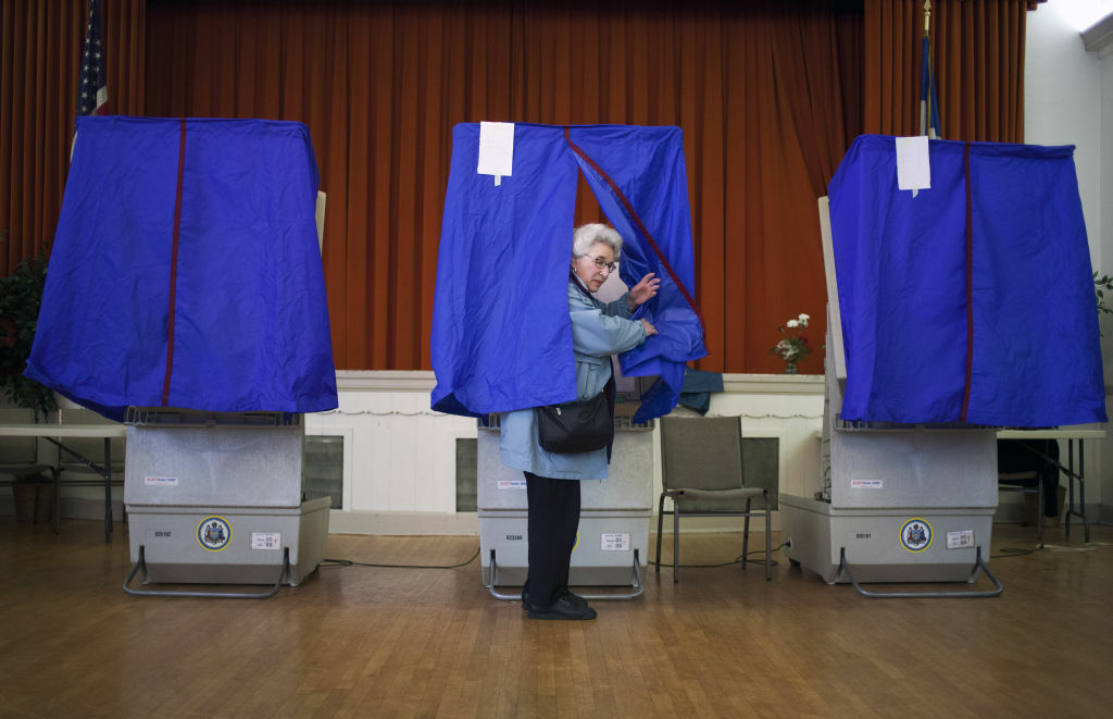 Lilyan Maitan stands in a voting booth during the Republican primary election April 24, 2012 at St. George Greek Orthodox Church in Philadelphia, Pennsylvania.