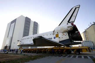 File photo: In this handout image provided by the National Aeronautics and Space Administration (NASA), space shuttle Endeavour approaches the Vehicle Assembly Building on its move from Orbiter Processing Facility-2 where it was processed for its final and upcoming STS-134 mission at NASA's Kennedy Space Center on February 28, 2011 in Cape Canaveral, Florida.