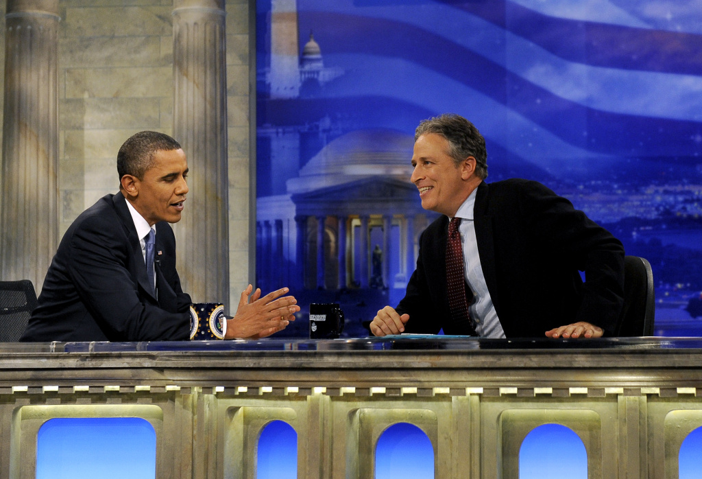 U.S. President Barack Obama (L) chats with Daily Show host Jon Stewart during a commercial break in taping on October 27, 2010 in Washington, D.C.