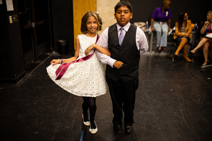 Ricardo Gonzalez  and Kyonica Bell, both 11 year old students from Manchester Elementary School, practice their moves backstage before the competition begins.
