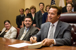 California Governor Arnold Schwarzenegger signs the state's budget solution on July 28, 2009 in Sacramento, California.