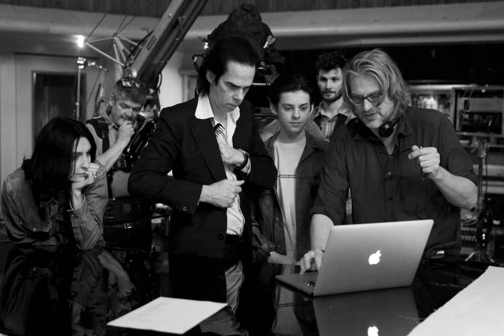 """(L-R) Nick Cave's wife Susie Cave, Nick Cave, Earl Cave and Andrew Dominik watch footage from the """"Skeleton Tree"""" recording session."""
