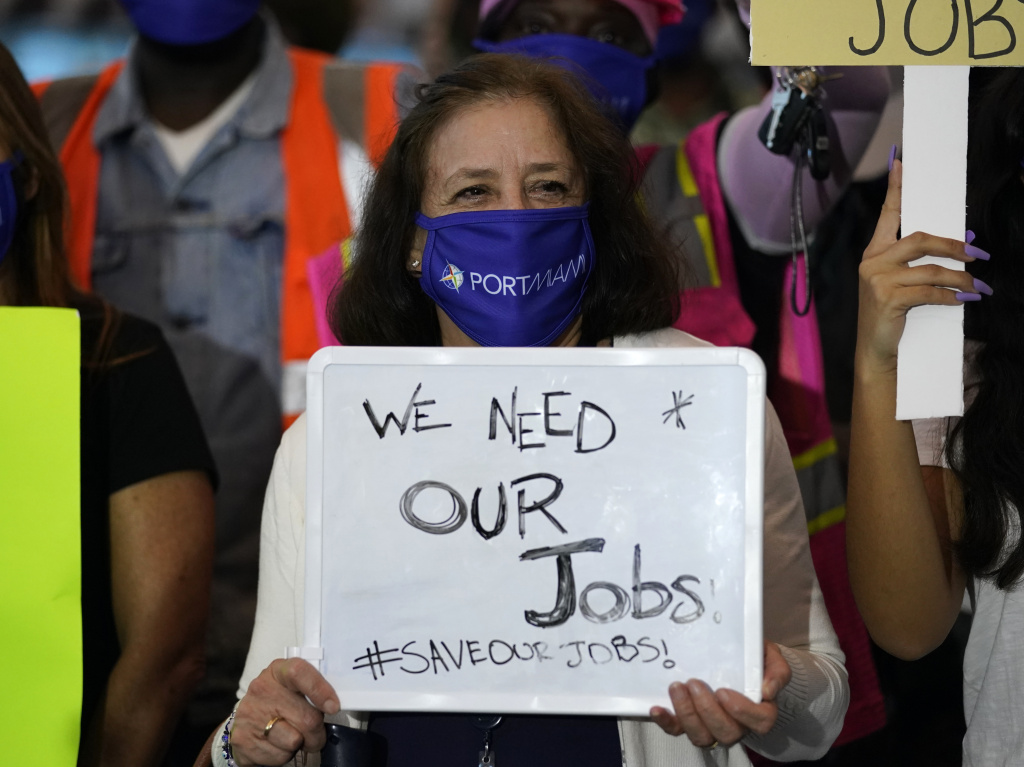 A women holds a sign saying