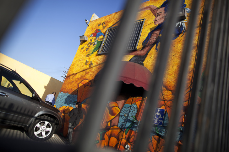 Muralist Manny Velazquez giving a tour of Pacoima's Mural Mile