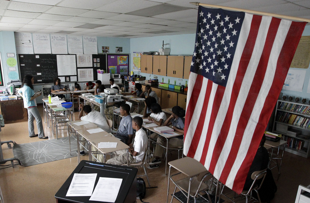 In this May 1, 2012 photo, teacher Kayla Morrow, standing at left, teaches an Advanced Placement government class at the Academy for College and Career Exploration in Baltimore. In May 2012, 2 million students took 3.7 million end-of-year AP exams, figures well over double those from a decade ago