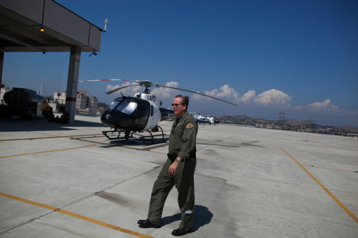 Tactical officer Greg MacDonald points his pilot Kevin Cook toward a spot to check as calls come in from LAPD dispatch.