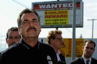 Los Angeles Police Department police chief Charlie Beck stands in front of one of 300 billboard showing a 'wanted' poster for two suspects wanted for the beating of a San Francisco Giants fan Bryan Stow  on May 17, 2011 in Los Angeles, California.