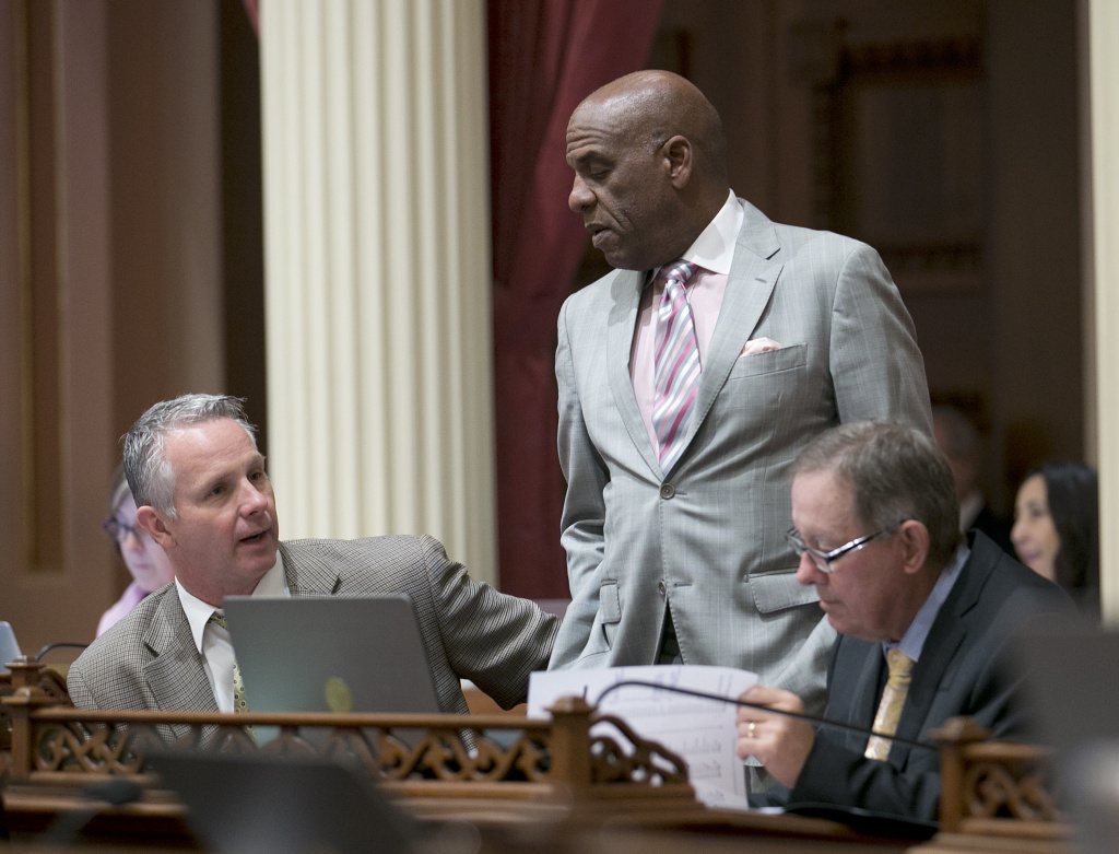State Sen. Steven Bradford, D-Gardena, center, talks with Republican Senators Anthony Cannella of Ceres, left, and Tom Berryhill of Twain Harte, at the Capitol in Sacramento on Thursday, June 1, 2017.