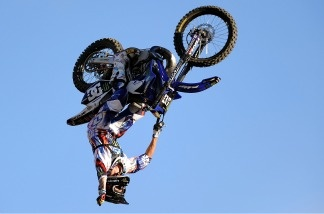 Nate Adams competes to a bronze medal in the Moto X Freestyle Final during X Games 16 at the LA Coliseum on July 29, 2010 in Los Angeles, California.