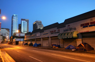 Homeless people sleep in their encampments in the Skid Row area of Downtown Los Angeles.