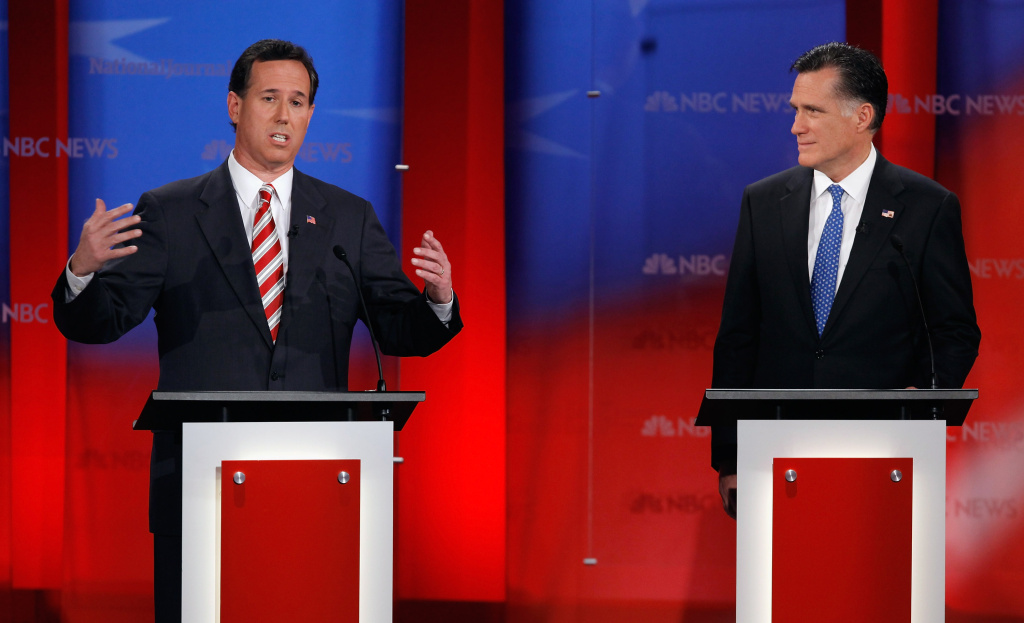Republican presidential candidates Rick Santorum (L) and Mitt Romney (R) at the NBC News, National Journal, Tampa Bay Times debate held at the University of South Florida in Tampa, Florida.