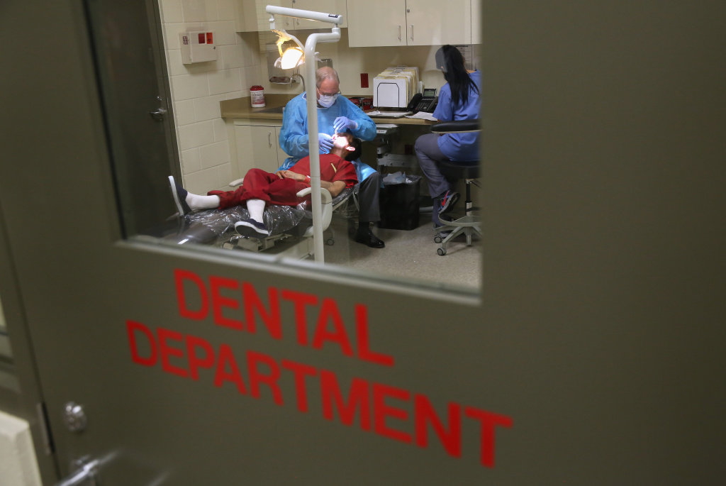 An immigrant receives dental care at the Adelanto Detention Facility on Nov. 15, 2013 in Adelanto.