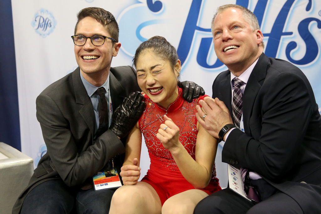 Mirai Nagasu celebrates in the kiss and cry with coaches Drew Meekins and Tom Zakrajsek after skating in the Ladies Free Skate during the 2018 Prudential U.S. Figure Skating Championships at the SAP Center on January 5, 2018 in San Jose, California.