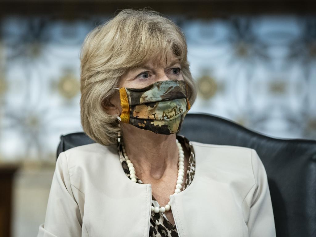 Sen. Lisa Murkowski, R-Alaska, wears a face covering during a committee hearing on June 30.