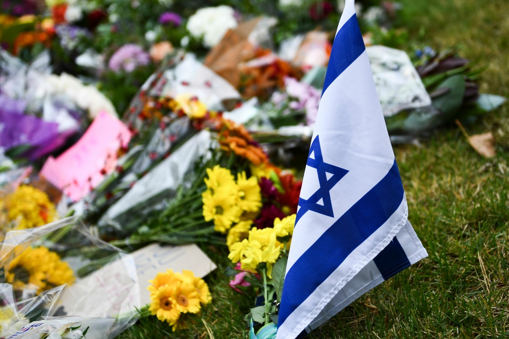 An Israeli national flag is seen at a memorial on October 28, 2018, down the road from the Tree of Life synagogue after a shooting there left 11 people dead in the Squirrel Hill neighborhood of Pittsburgh on October 27, 2018.