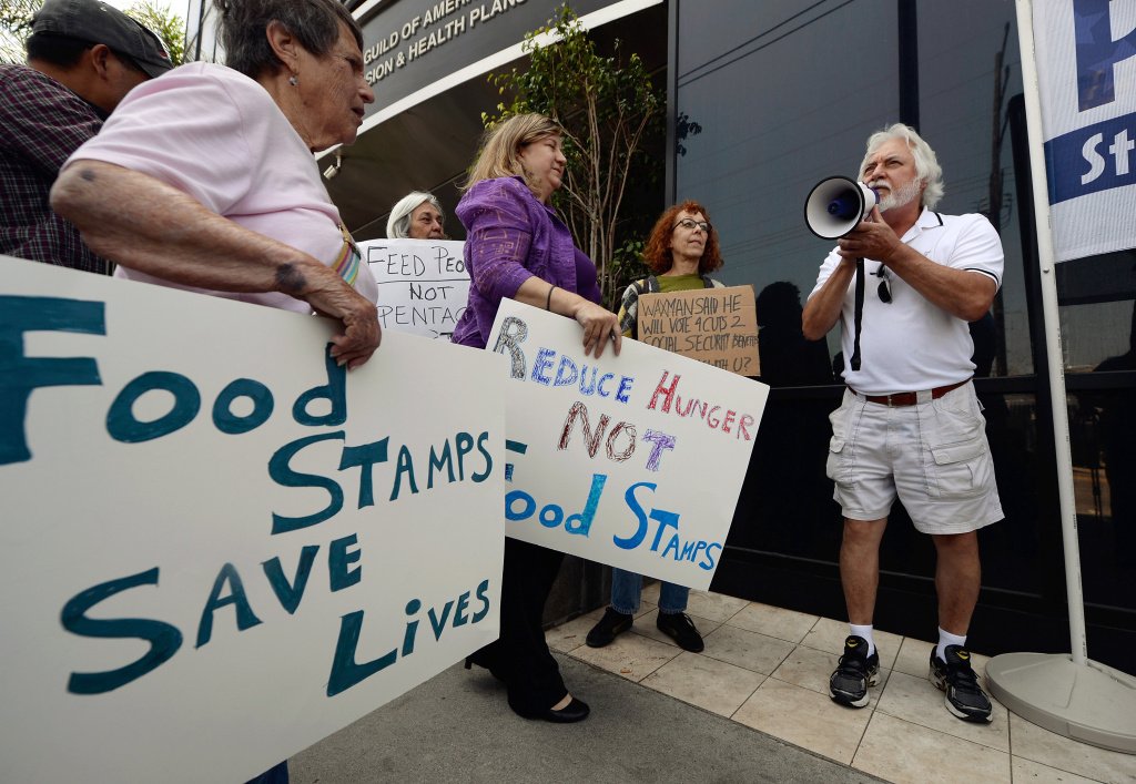 Tom Camarello with Progressive Democrats of America and members from several other organizations hold a rally in front of Rep. Henry Waxman's office on June 17, 2013 in Los Angeles, California. The protestors were  asking the congressman to vote against a House farm bill that would reduce federal spending on the Supplemental Nutritional Assistance Program by $20.5 billion and affect food stamps and other services for the poor.