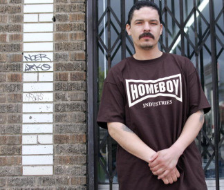 Former gang member who uses the nickname 'Jose Aleman,' 34, wears a Homeboy Industries tee shirt, while posing for a photo on a street in East Los Angeles, California, 23 March, 2005. Homeboy Industries is an organization trying to foster new lives for gang members.