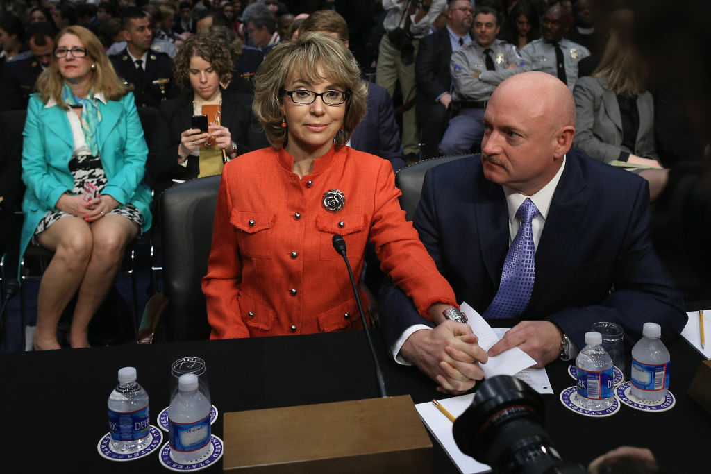 Retired NASA astronaut and Navy Capt. Mark Kelly (R) and his wife, shooting victim and former U.S. Rep. Gabby Giffords (D-AZ) prepares to give an opening statement before the Senate Judiciary Committee during hearing about gun control on Capitol Hill January 30, 2013 in Washington, DC. Giffords delivered an opening statment to the committee, which met for the first time since the mass shooting at a Sandy Hook Elementary School in Newtown, Connecticut.