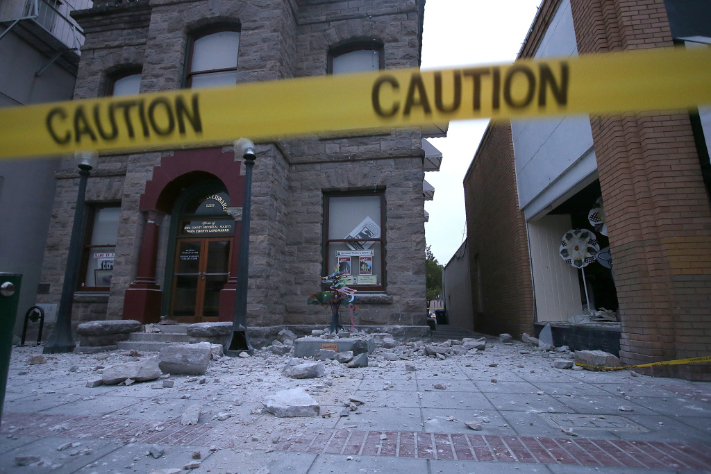 Debris sits on the ground in front of a damaged building following a reported 6.0 earthquake on August 24, 2014 in Napa, California.