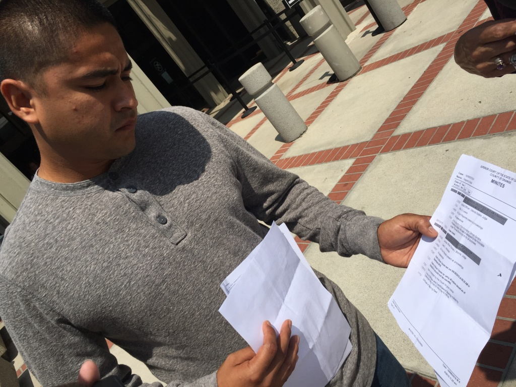 Enrique Degante, 27 of Santa Ana, shows court paper work that summoned him to Orange County Superior Court in Westminster for a traffic-related cases that was supposedly dismissed in 2014. The FBI is investigating whether an O.C. Superior Court clerk illegally fixed thousands of cases starting in 2010 for payment.