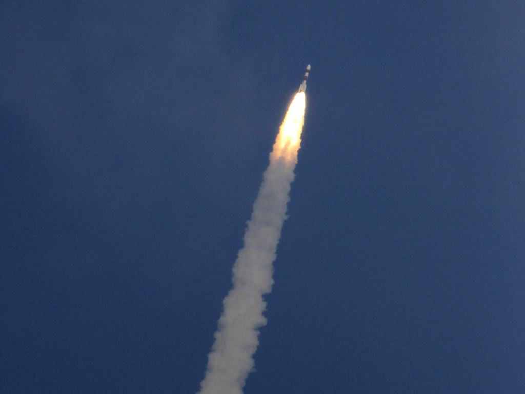 A rocket carrying the Mars orbiter lifts off from the east-coast island of Sriharikota, India, on Tuesday.