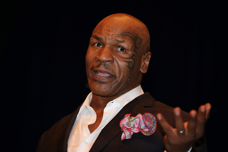 Mike Tyson speaks on stage during his speaking tour,