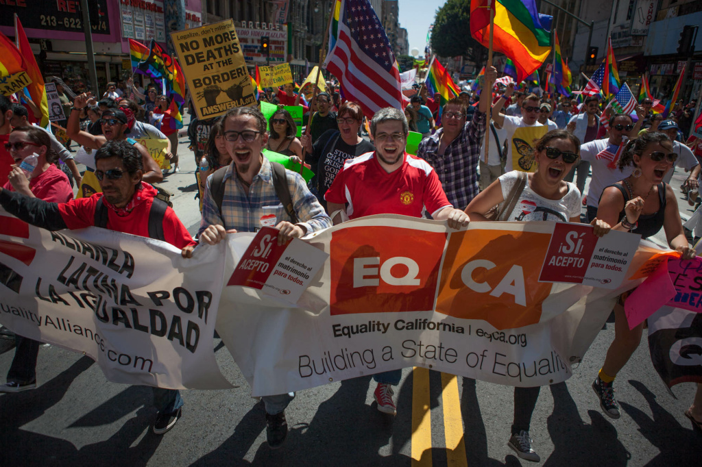Members of LGBT groups march on Broadway during the May 1, 2013 May Day immigrant rights march in Los Angeles. An amendment to the Senate immigration reform bill that would have allowed gay and lesbian U.S. citizens to sponsor a same-sex spouse for an immigrant visa was withdrawn.