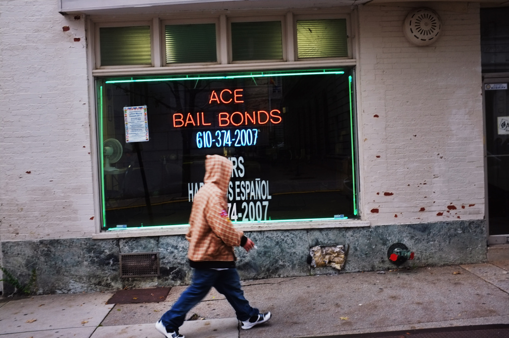 A man walks by a bail bonds store on October 20, 2011 in Reading, Pennsylvania.