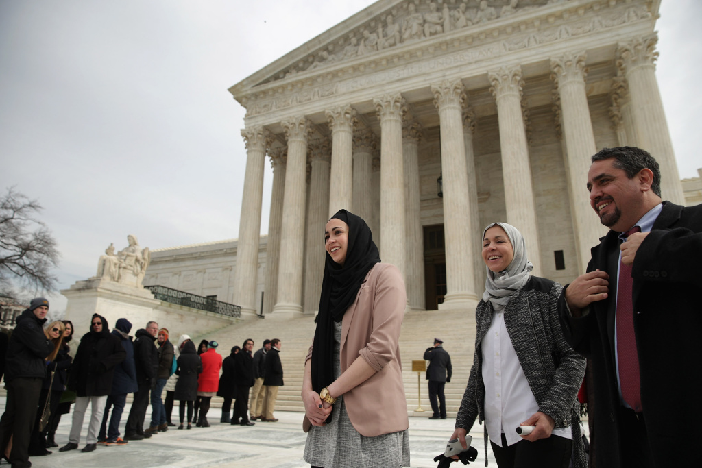 Samantha Elauf (C), her mother Majda Elauf (2nd R) of Tulsa, Oklahoma, and Equal Employment Opportunity Commission General Counsel David Lopez (R) leave the U.S. Supreme Court after the court heard oral arguments in EEOC v. Abercrombie & Fitch February 25, 2015 in Washington, DC.