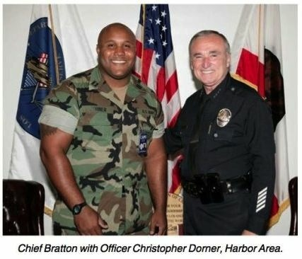 Murder suspect and former LAPD officer Christopher Jordan Dorner in an image with then-LAPD Chief Bill Bratton, in the August 2006 issue of the department's magazine BEAT.